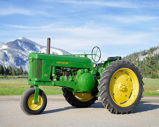 TRA 01 RK0428 01 © Kimball Stock 1952 John Deere 60 Tractor Green 3/4 Front View By Meadow Mountains