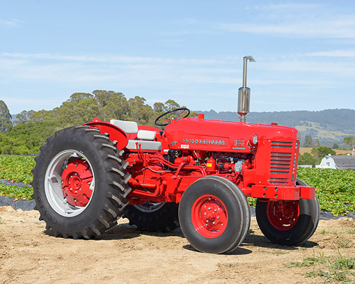 TRA 01 RK0432 01 © Kimball Stock 1955 International Harvester 300 Utility Tractor Red 3/4 Front View On Farm