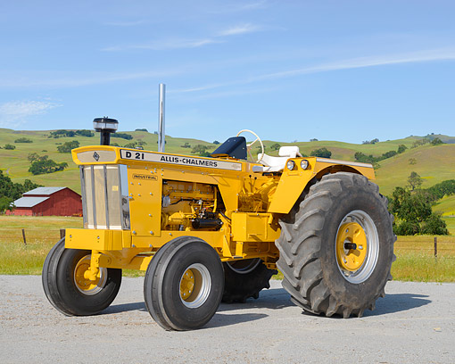 TRA 01 RK0437 01 © Kimball Stock 1965 Allis-Chalmers D21 Series II Tractor Yellow 3/4 Front View On Farm