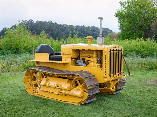 TRA 01 RK0446 01 © Kimball Stock 1937 Caterpillar R-2 Yellow 3/4 Front View By Spring Bushes