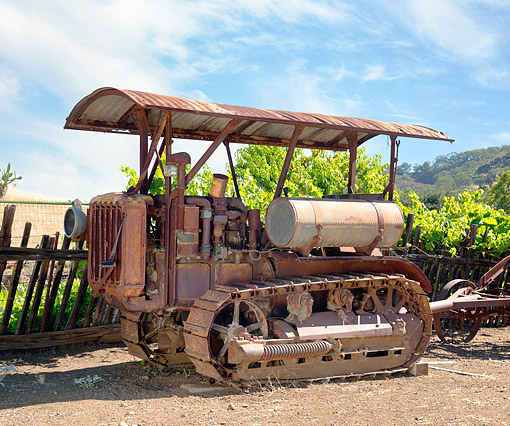 TRA 01 RK0447 01 © Kimball Stock 1930 Caterpillar Thirty Tractor Rusted 3/4 Front View By Fence And Hills