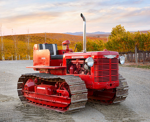 TRA 01 RK0448 01 © Kimball Stock 1940 International TD-6 Tractor Red 3/4 Front View On Wet Gravel By Vineyard
