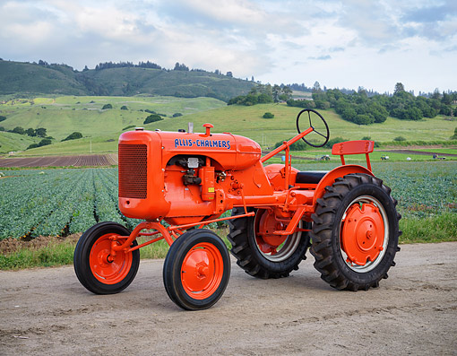 TRA 01 RK0460 01 © Kimball Stock 1939 Allis-Chalmers B Tractor Orange 3/4 Front View By Crops