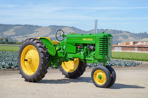 TRA 01 RK0462 01 © Kimball Stock 1949 John Deere MT Green 3/4 Front View By Crops On Farm