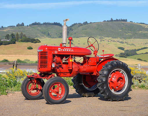 TRA 01 RK0464 01 © Kimball Stock 1944 McCormick Farmall A Red 3/4 Front View On Farm By Hills