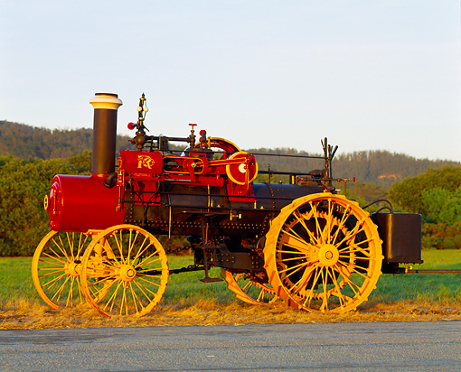 TRA 01 RK0002 06 © Kimball Stock 1905 Russell Steam Tractor Side View On Grass At Dusk