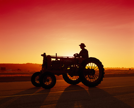 TRA 01 RK0004 04 © Kimball Stock 1935 Farmall F-12 Tractor With Man Sunset Silhouette