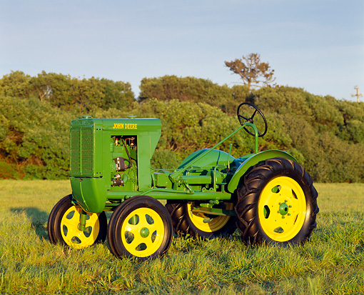 TRA 01 RK0006 02 © Kimball Stock 1939 John Deere Unstyled L Tractor On Grass Trees