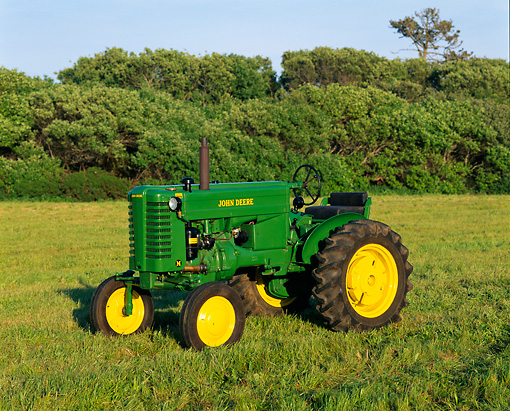 TRA 01 RK0010 02 © Kimball Stock John Deere M Tractor On Grass Trees