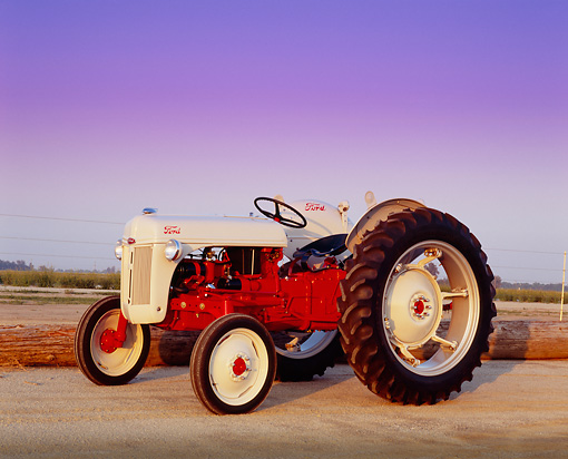 TRA 01 RK0055 02 © Kimball Stock 1948 Ford 8N High Crop Tractor Red And Beige 3/4 Side View On Dirt
