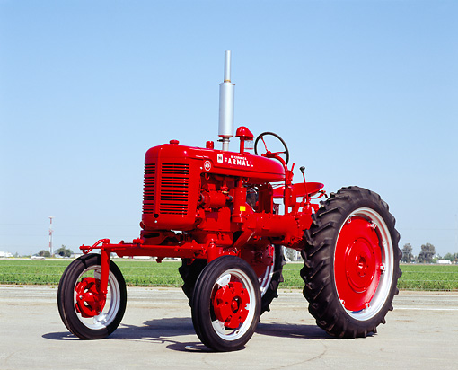 TRA 01 RK0068 04 © Kimball Stock 1940's Farmall AV Red Tractor 3/4 Front View On Pavement Blue Sky