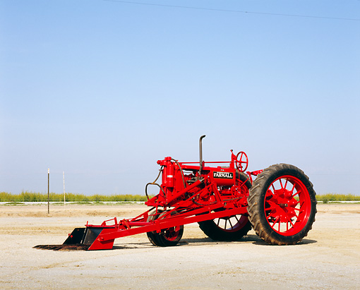 TRA 01 RK0085 01 © Kimball Stock 1938 McCormick Deering Farmall F-12 Red Tractor 3/4 Front View On Dirt Blue Sky