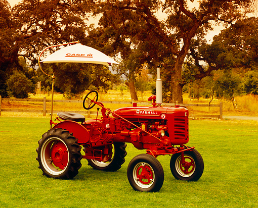 TRA 01 RK0106 02 © Kimball Stock 1951 International Harvester Farmall A Red With Umbrella 3/4 Side View On Grass