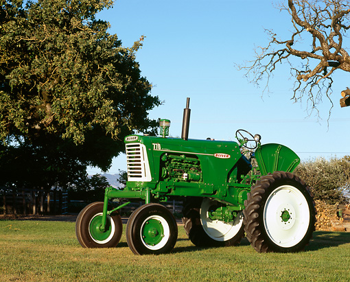 TRA 01 RK0111 03 © Kimball Stock 1960 Oliver 770 Green And White Tractor 3/4 Side View On Grass