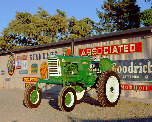 TRA 01 RK0112 02 © Kimball Stock 1960 Oliver 770 Green And White Tractor 3/4 Front On Gravel By Decals