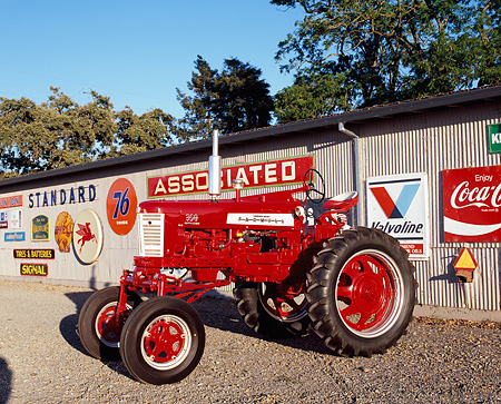 TRA 01 RK0123 01 © Kimball Stock 1958 Farmall 350 High Clearance Red And White 3/4 Side View On Gravel By Decals