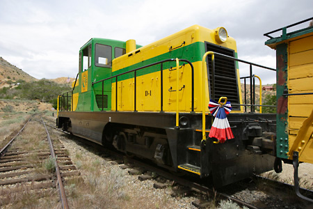 TRN 01 RK0001 01 © Kimball Stock Train On Tracks Yellow And Green 3/4 Front View
