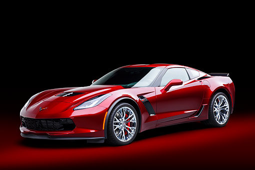 VET 01 BK0070 01 © Kimball Stock 2016 Chevrolet Corvette Z06 Supercar Supercharged 6.2L V8 Red 3/4 Front View In Studio