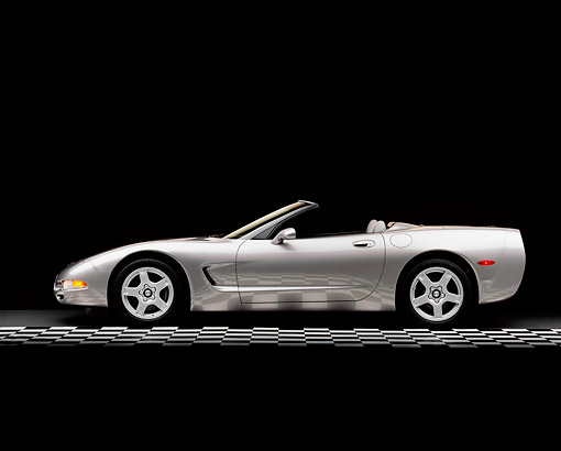 VET 01 RK0184 02 © Kimball Stock 1998 Pewter Metallic Gray Chevy Corvette Convertible Profile On Checkerboard Lights On