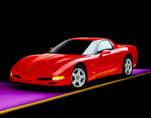 VET 01 RK0322 01 © Kimball Stock 1999 Chevrolet Corvette Hardtop Red 3/4 Front View On Yellow And Red Line Studio