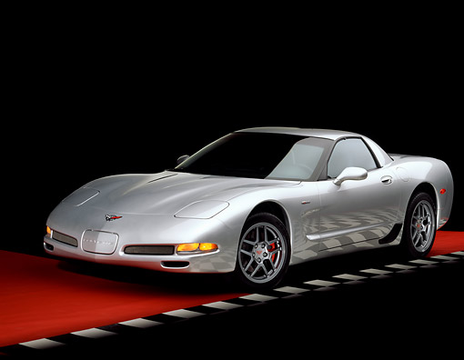 VET 01 RK0512 10 © Kimball Stock 2001 Chevrolet Corvette Z06 Silver 3/4 Front View On Red Floor Checkered Line Studio