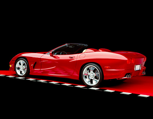 VET 01 RK0591 05 © Kimball Stock 2002 Avelate Corvette Roadster Red 3/4 Rear View On Red Floor Checkered Line Studio