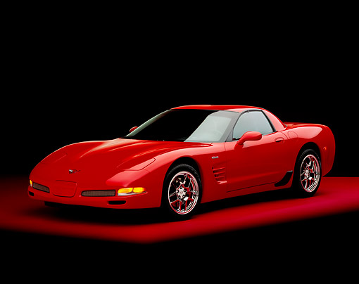 VET 01 RK0626 04 © Kimball Stock 2004 Chevrolet Corvette Z06 Red 3/4 Front View On Red Floor Studio