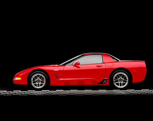 VET 01 RK0628 05 © Kimball Stock 2004 Chevrolet Corvette Z06 Red Side View On Checkered Floor Studio