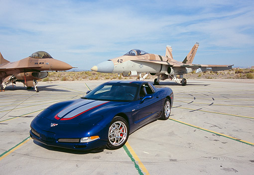 VET 01 RK0665 04 © Kimball Stock 2004 Chevrolet Corvette Z06 Blue 3/4 Front View By Jet Fighter Airplane