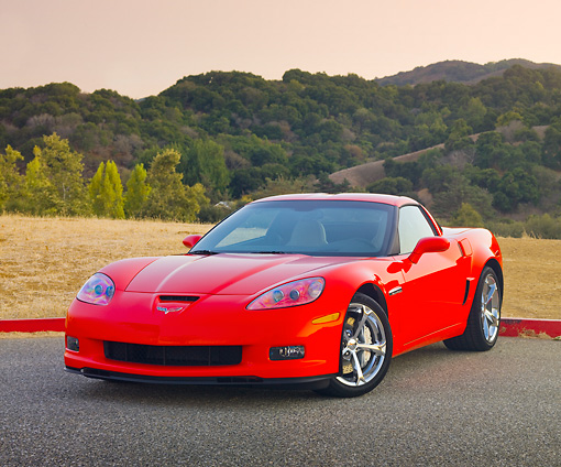 VET 01 RK0931 01 © Kimball Stock 2010 Chevrolet Corvette Grand Sport Red 3/4 Front View On Pavement By Hills