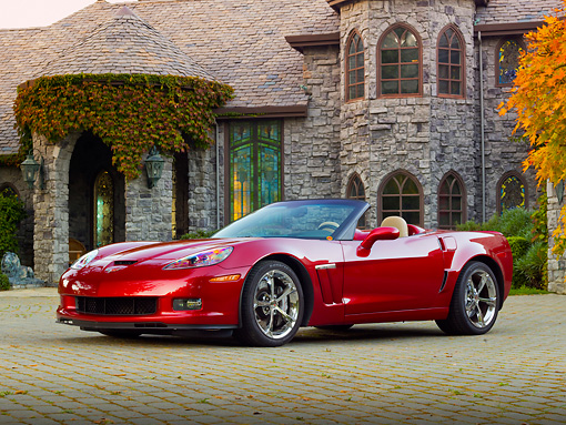 VET 01 RK0984 01 © Kimball Stock 2011 Chevrolet Corvette GS Convertible Red 3/4 Front View On Brick By House