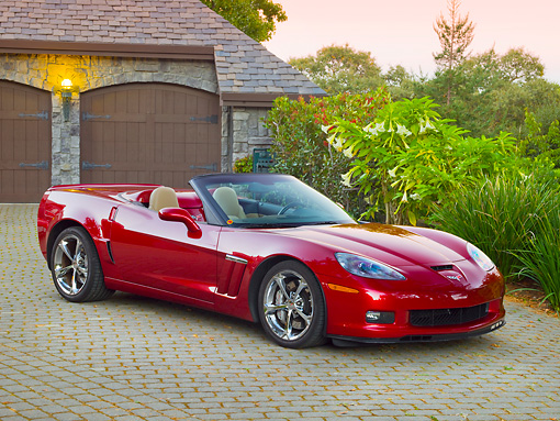 VET 01 RK0990 01 © Kimball Stock 2011 Chevrolet Corvette GS Convertible Red 3/4 Front View On Brick By House