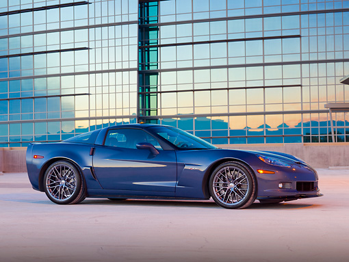 VET 01 RK0998 01 © Kimball Stock 2011 Chevrolet Corvette Z06 Blue Profile View On Pavement By Building At Dusk