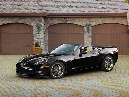 VET 01 RK1023 01 © Kimball Stock 2011 Chevrolet Corvette GS Convertible Black 3/4 Front View On Brick By House
