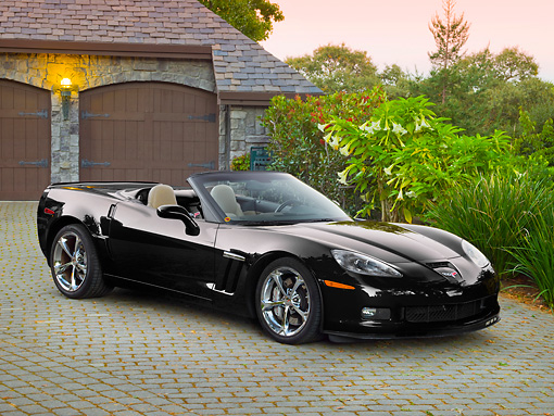 VET 01 RK1025 01 © Kimball Stock 2011 Chevrolet Corvette GS Convertible Black 3/4 Front View On Brick By House