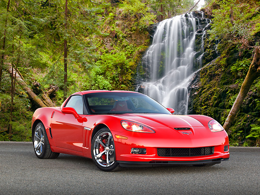 VET 01 RK1035 01 © Kimball Stock 2012 Chevrolet Corvette Red 3/4 Front View On Pavement By Waterfall
