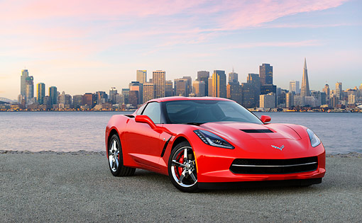 VET 01 RK1105 01 © Kimball Stock 2014 Chevrolet Corvette Stingray Red 3/4 Front View On Pavement By Bay And City Skyline