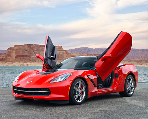 VET 01 RK1109 01 © Kimball Stock 2014 Chevrolet Corvette Stingray Red 3/4 Front View On Pavement By Water And Desert