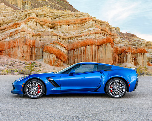 VET 01 RK1130 01 © Kimball Stock 2015 Chevrolet Corvette Z06 Blue Profile View On Pavement In Desert