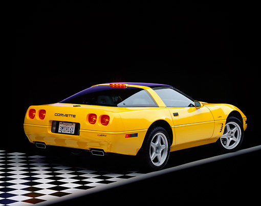 VET 01 RK0067 01 © Kimball Stock 1995 Chevrolet Corvette ZR1 Yellow 3/4 Rear View On Checkered Floor Studio