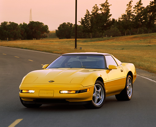 VET 01 RK0074 01 © Kimball Stock 1995 Chevrolet Corvette ZR1 Yellow 3/4 Front View On Road