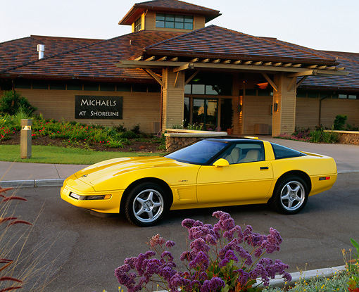 VET 01 RK0076 04 © Kimball Stock 1995 Chevy Corvette ZR1 Yellow 3/4 Side On Pavement