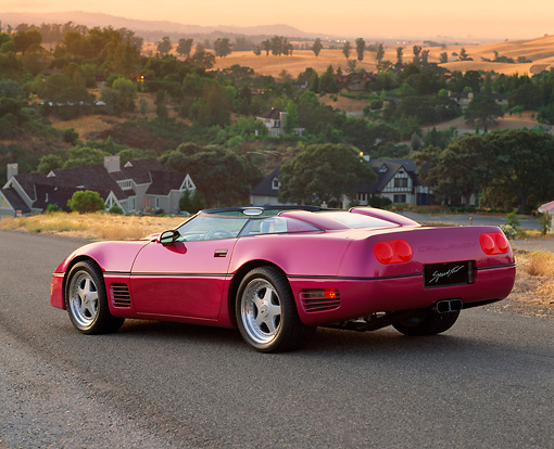 VET 01 RK0133 03 © Kimball Stock 1991 Chevrolet Corvette Callaway Twin Turbo Speedster Fuchsia 3/4 Rear View On Pavement