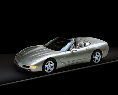 VET 01 RK0188 05 © Kimball Stock 1998 Pewter Metallic Gray Corvette Overhead 3/4 Side On Gray Line Lights On Studio Background