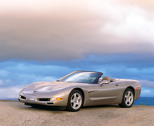 VET 01 RK0192 03 © Kimball Stock 1998 Chevrolet Corvette Convertible Pewter 3/4 Side View On Pavement Gray Clouds