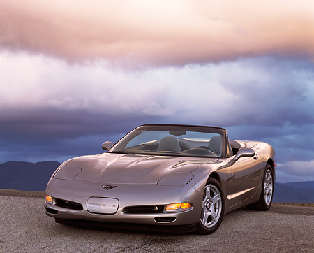 VET 01 RK0195 03 © Kimball Stock 1998 Chevrolet Corvette Convertible Pewter 3/4 Front View On Pavement Gray Clouds