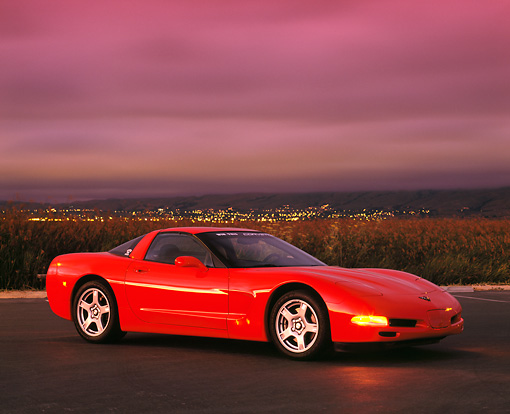 VET 01 RK0287 06 © Kimball Stock 1998 Chevrolet Corvette C5 Red 3/4 Side View On Pavement At Night