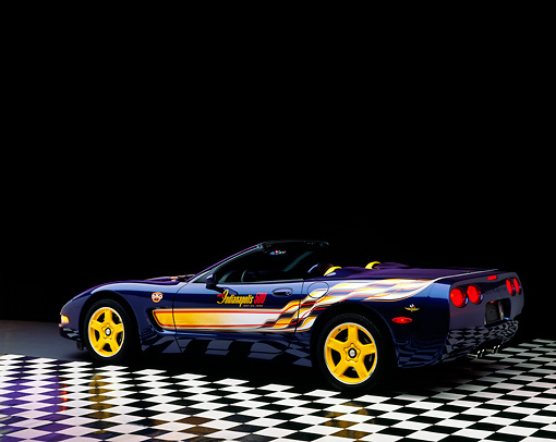 VET 01 RK0291 02 © Kimball Stock 1998 Chevrolet Corvette Convertible Pace Car Blue 3/4 Rear On Checkerboard Studio