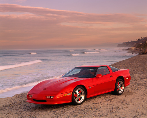 VET 01 RK0332 05 © Kimball Stock 1990 Chevrolet Corvette Shinoda Red Side 3/4 View On Sand