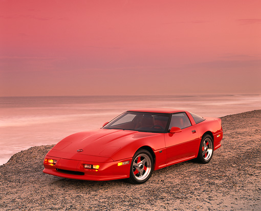 VET 01 RK0335 08 © Kimball Stock 1990 Chevrolet Corvette Shinoda Red Front 3/4 View On Sand